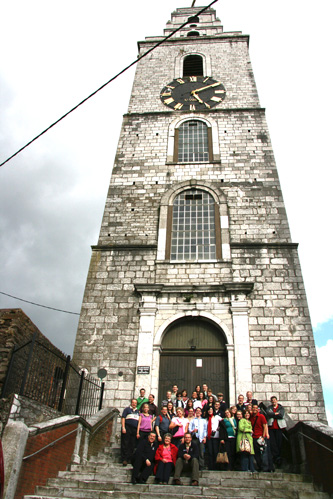 Some of the choir in front of same tower as above
